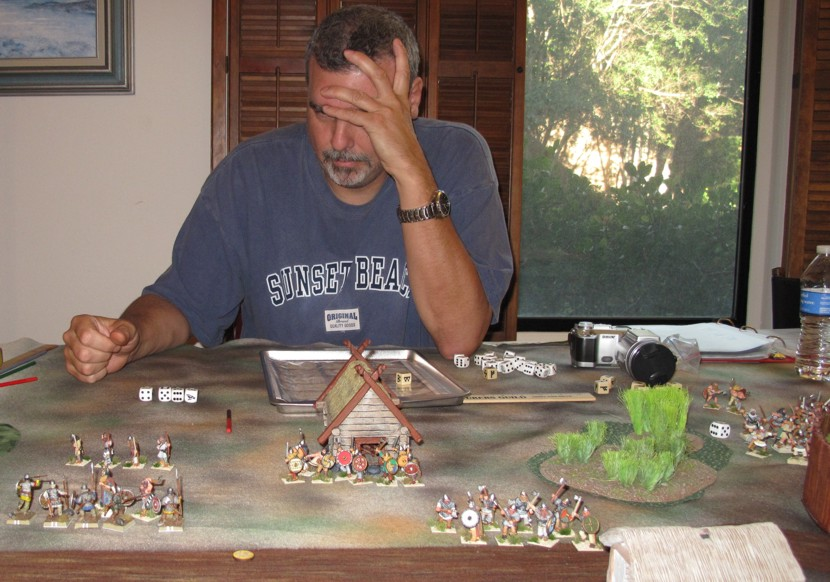 This picture says it all, Tim wondering what happened.... his Warlord with only one Beserker left (at lower left) facing my band of Warriors is about to die.